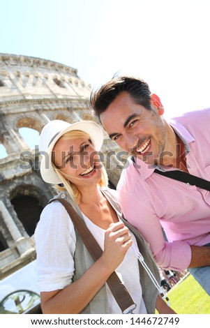Cheerful couple of tourists in Rome