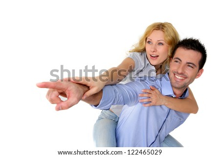 Cheerful couple pointing at one side - stock photo