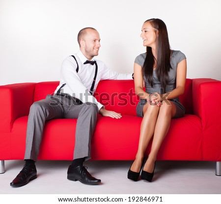 cheerful couple relaxing in sofa at home - stock photo