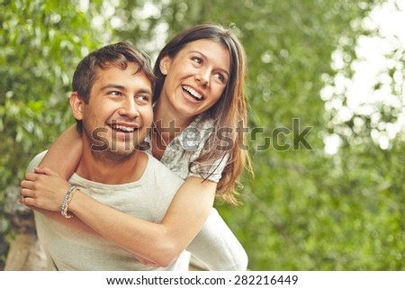 Cheerful couple spending time outdoors - stock photo