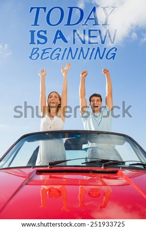 Cheerful couple standing in red cabriolet against today is a new beginning - stock photo