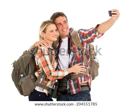 cheerful couple tourists taking selfie with smart phone - stock photo
