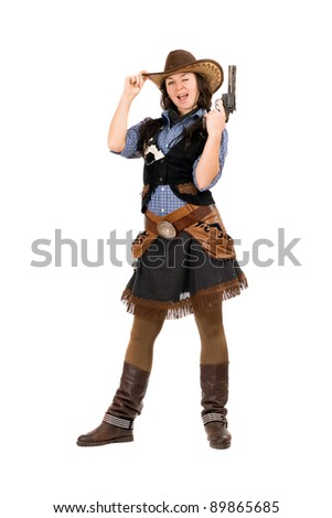 Cheerful cowgirl with a gun in hands. Isolated on white - stock photo