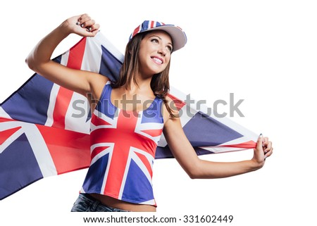 Cheerful cute English girl holding a flag, wearing a tank top and a cap with Union Jack flag, patriotism and enjoyment concept - stock photo