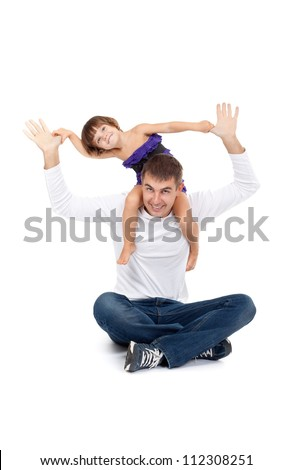 Cheerful daughter on the neck with his father in the studio on a white background - stock photo