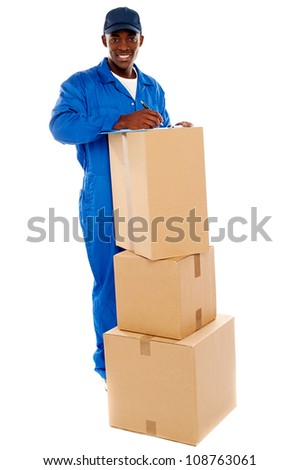 Cheerful delivery guy preparing receiving notice. Isolated over white