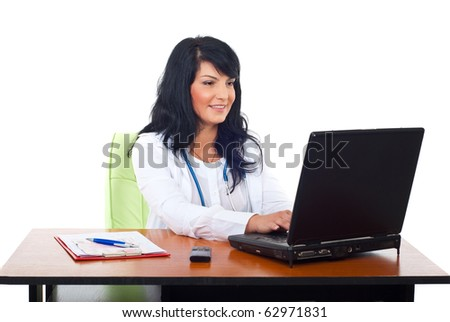 Cheerful doctor woman typing on laptop in her office isolated on white background