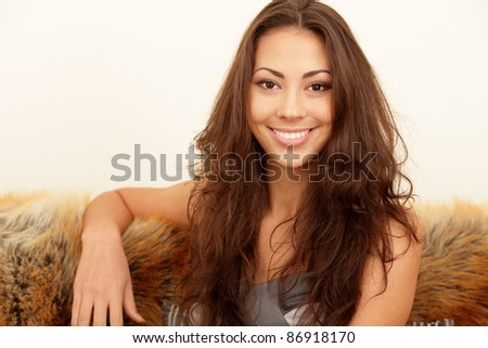 Cheerful elegant smiling woman of a mixed race - stock photo