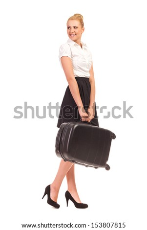 Cheerful elegant young woman with black suitcase, smiling and looking away. Full length studio shot isolated on white. - stock photo