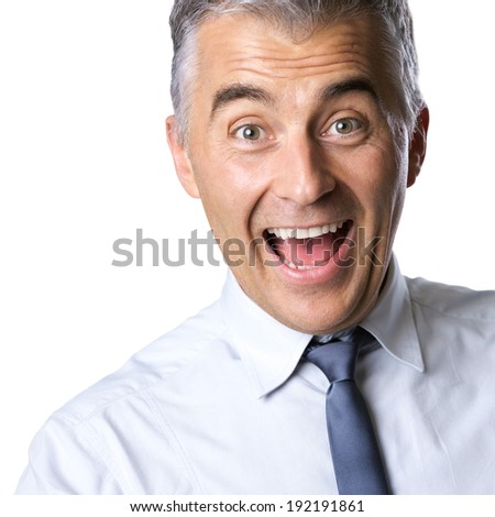 Cheerful excited businessman with mouth open and raised eyebrows on white background. - stock photo