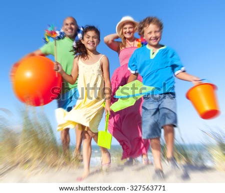 Cheerful Family Bonding Beach Vacation Holiday Concept - stock photo
