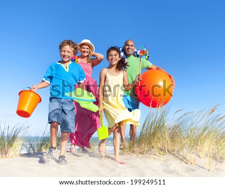Cheerful Family Bonding by the Beach - stock photo