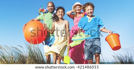Cheerful Family Bonding by the Beach Holiday Concept - stock photo