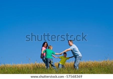 cheerful family dancing round - stock photo