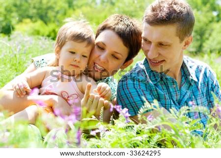 Cheerful family having fun outdoors - stock photo