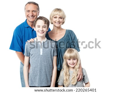 Cheerful family of four members posing together  - stock photo