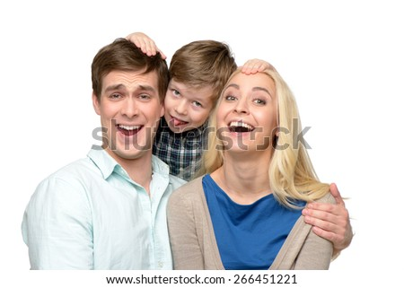 Cheerful family of three having fun. Little boy hugging his parents. Isolated on white background. Concept for happy family - stock photo