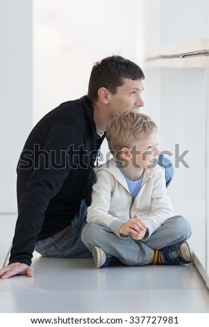 cheerful family of two sitting at the airport - stock photo