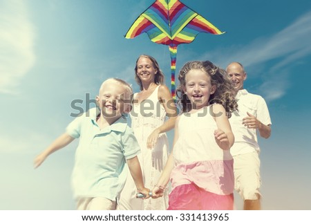 Cheerful Family Playing by the Beach Concept - stock photo