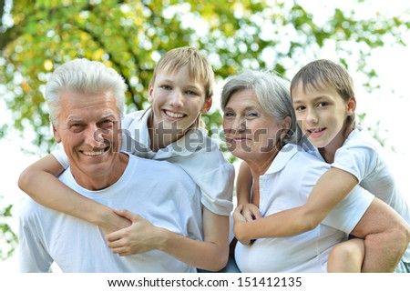 Cheerful family standing on a background of nature