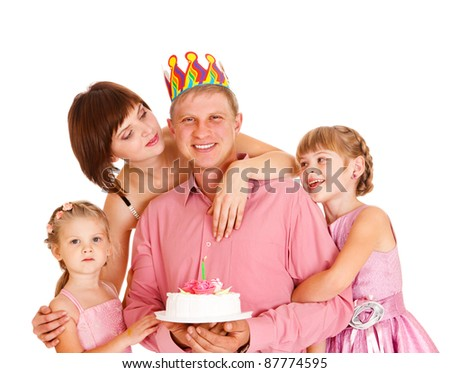 Cheerful father with birthday cake and his family embracing him, isolated - stock photo