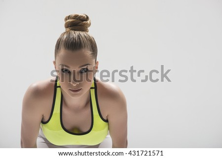Cheerful female athlete in starting position - stock photo