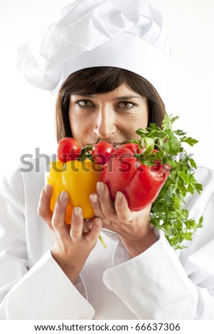 Cheerful Female Chef With Vegetables