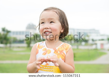 Cheerful female child expressing joy and excitement - stock photo