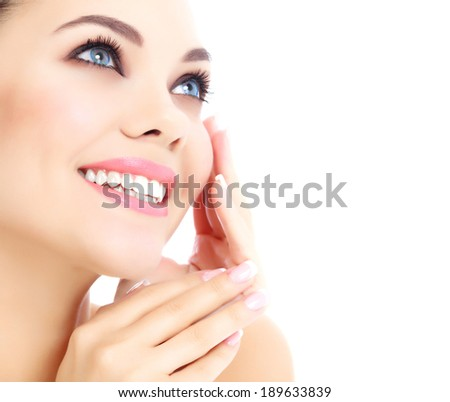Cheerful female with fresh clear skin, white background.  - stock photo