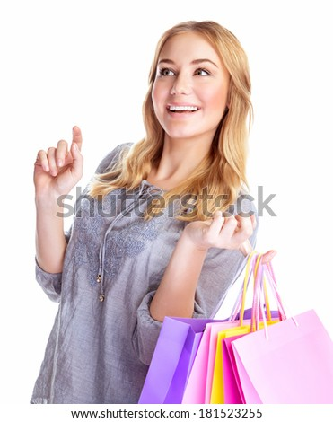 Cheerful female with paper bags isolated on white background, happy shopaholic, buying presents, making purchase, season sales concept  - stock photo