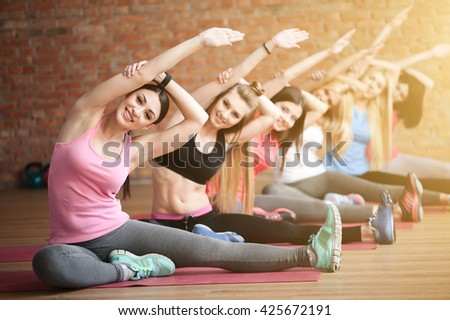 Cheerful fit girls are going for sports - stock photo