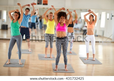 Cheerful fitness group dancing