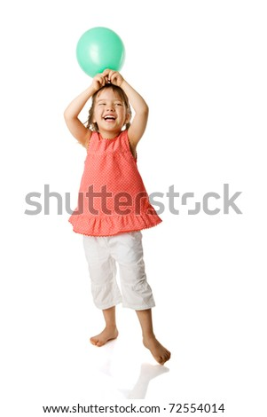 Cheerful five year girl holding balloon isolated on white