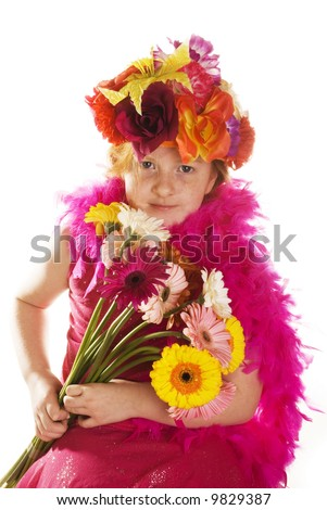 cheerful flowerchild with hat and bunch flowers - stock photo