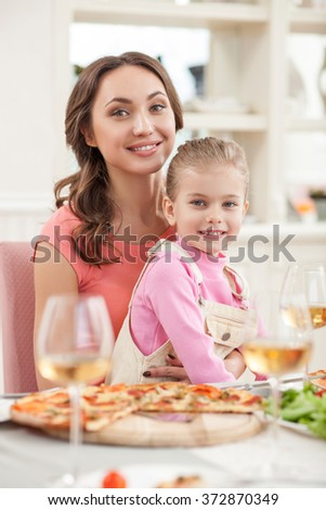 Cheerful friendly family has a dinner - stock photo
