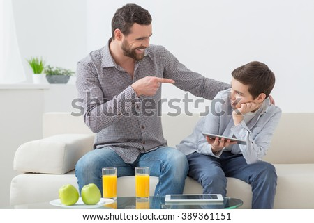 Cheerful friendly family is spending time together - stock photo