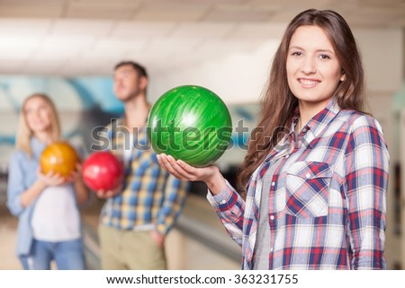 Cheerful friendly sport team is playing kegling  - stock photo