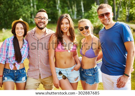 Cheerful friends having rest on weekend - stock photo