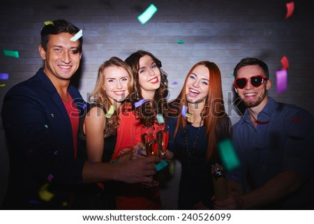 Cheerful friends toasting with champagne at party - stock photo