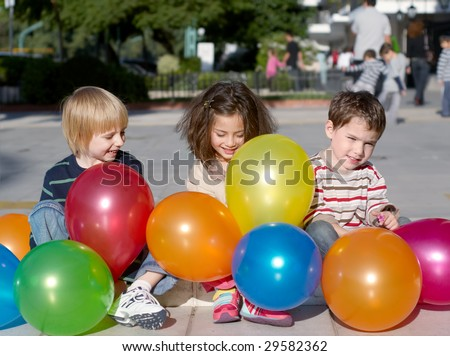 Cheerful friends with multi-coloured inflatable spheres outdoors, - stock photo