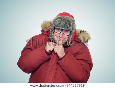 Cheerful funny man in glasses and winter clothes - stock photo