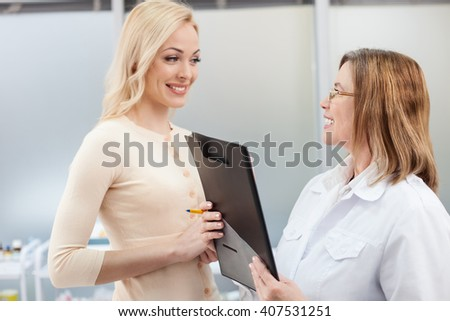 Cheerful general practitioner is working with patient - stock photo