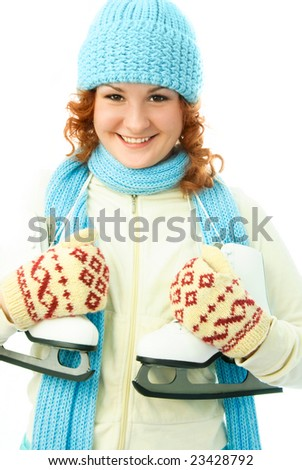 cheerful ginger girl wearing warm winter clothes goes ice-skating - stock photo