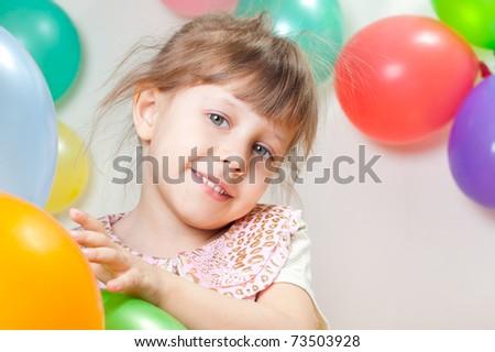 Cheerful girl among the balloons - stock photo