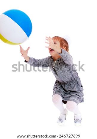Cheerful girl catches the ball.Isolated on white background - stock photo