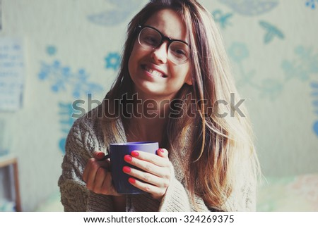 cheerful girl drinking coffee in bed - stock photo