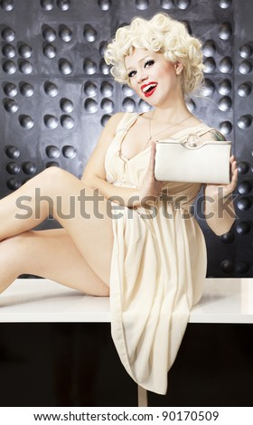 Cheerful girl holding a clutch bag - stock photo