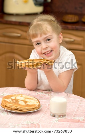 Cheerful girl holding a delicious pancake - stock photo