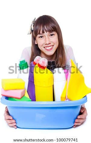 Cheerful girl holding basin with cleansers - stock photo