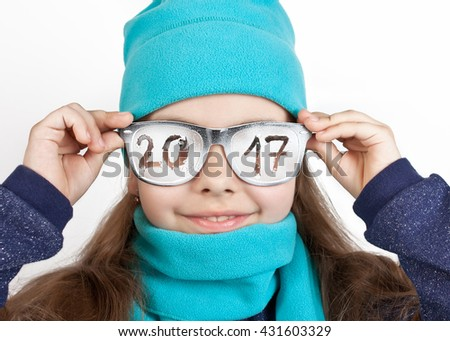 "Cheerful girl in a cap and scarf in funny glasses with the inscription ""2017"" - stock photo"
